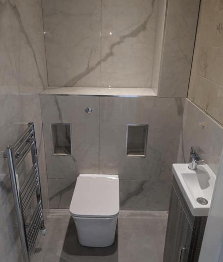 Large format porcelain tiles. Marble 1.6m X .8m and grey floor tiles 1.2m X 1.2m