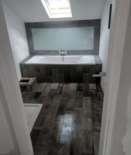 Rustic plank bathroom tiles